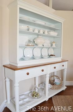 Like the pale blue color with white and wood tones.