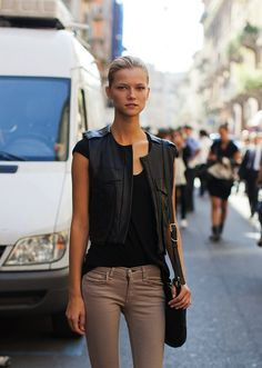 Black top + black leather vest + tan skinnies