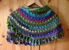 I just love this shawl in all its colored versions...