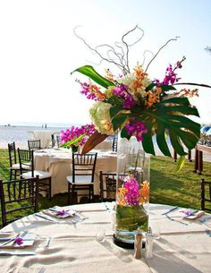 Are you having your wedding in a tropical area? You need to choose the best tropical wedding flowers for your special day. They should withstand the heat and humidity to avoid withering before the day's events are completed. Tropical Wedding Centerpieces, Tropical Floral Arrangements, Flower Centerpieces, Tropical Flowers, Hawaiian Centerpieces, Tropical Weddings, Wedding Themes, Wedding Decorations, Wedding Ideas