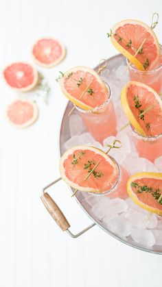 The Recipe for the Perfect Summertime Paloma! Fill serving glass a little more than half full of ice.  Pour in 2 oz of fresh grapefruit juice. Add 1 tablespoon of fresh lime juice. Add 2 oz club soda. Add 2 oz tequila. Stir to combine.  Add more ice if necessary.  Garnish finished cocktail with a grapefruit slice and sprig of thyme.