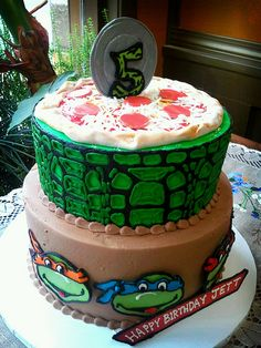 tmnt cake idea- would like sewer lid on top instead of pizza