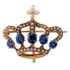 1900s Crown Brooch of Seed Pearls and Sapphires | From a unique collection of vintage brooches at https://www.1stdibs.com/jewelry/brooches/brooches/                                                                                                                                                                                 More