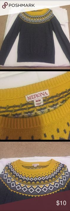 A grey medium sweater. It's new and only worn a couple times with a yellow design on upper area Merona Sweaters Crew & Scoop Necks