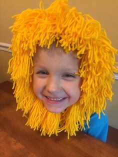 """DIY Lions mane.   Use a craft store elastic headband with holes, and yarn.  Make about 16 puff balls by wrapping yarn around a book or something that's 6"""" (or larger if you want a longer mane).  Tie in the middle and cut the loops.   Tie the puff ball on to the headband, repeat until it's as full as you want it."""
