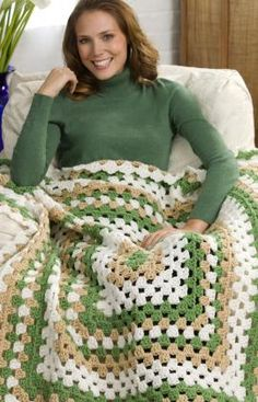 Weekend Granny Throw Crochet Pattern - This graphically interesting throw is easy to make. Start at the center with thicker than usual yarn and make just one great big granny square. It's crocheted in one piece, so there is nothing to sew together.