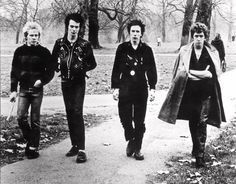 """With the emersion of """"punk"""" rock music in 1977 came punk fashion, characterized by messy, baggy, ripped clothes typically in denim or black leather styles."""
