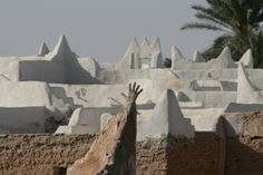 The hand projects and protects  The Ghadames old town, a world heritage site, built of mud-brick covered by gypsum. Located in Libya near the border with Algeria and Tunisia.