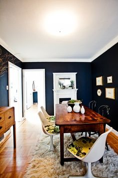 Dining space (navy puts a dramatic spin on ugly traditional wood color)