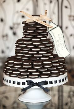 Brides.com: . A three-tiered stacked Oreo cookie wedding cake, created by Viewpoint Catering.