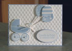 This card features hand stamped baby buggies, embossed & sponged balloons and the phrase peek-a-boo to someone new! The card that measures 5 1/2 x 4 1/4, and was made using Stampin Up card stocks, the Irresistibly Yours dsp, inks and the stamp sets. The buggies are hand stamped, then die-cut and popped with foam squares. The balloons are made using the embossed dsp, which I sponged in coordinating colors, then punched out and popped with foam squares. The peek-a-boo phrase ha...