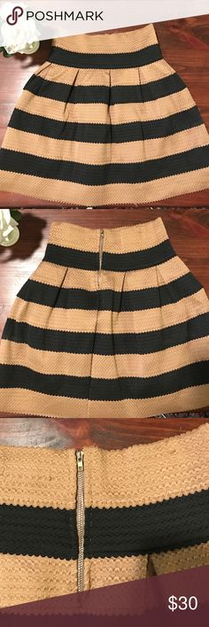 """Gorgeous Striped Tan & Black Skirt Sz Medium Beautiful skirt meant to be worn at the waist. It has quite a bit of stretch and definitely holds its shape! There are two little snags on the back, not noticeable but are shown in 2nd picture. Perfect with silk blouse and boots or heels! Waist is 24"""", bottom is 48"""" around, and length is 19"""". Could fit from size 2/4-8. Neslay Skirts Mini"""