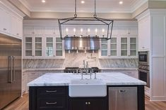 black+white cabinets, grey walls, swirl marble and cool chandelier!