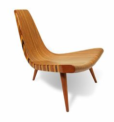 """Joaquim Tenreiro, Cadeira de tres pes (Three Legged Chair) 1947. Walnut, ivory, wood, rosewood and mahogany roxinho. """"A light that has nothing to do with the weight itself, but with graciousness, functionality into their spaces."""" This found great resonance in modernist architects like Oscar Niemeyer, its major customer. Tenreiro designed furniture for Niemeyer's houses and created pieces which adapted to the tropical heat of the country, using the straw abundamente and the Brazilian timbers."""