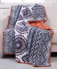 Add dynamic style to your décor with this cozy reversible throw bringing versatility to your living space.
