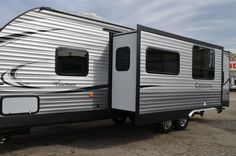 """KIDS WILL LOVE THIS BUNKHOUSE RV!!  2017 Coachmen Catalina Legacy Edition 293QBCK The large, rear bunkhouse in this 33' 5"""", 6,572 lb. (dry) RV gives your little campers a place to call their own in the great outdoors. The multiple bunks, COA cubes, and TV cabinet are perfect for fun sleepovers. You'll love the lovely kitchen, full bathroom, and outside kitchen with large awning! Give our Catalina Legacy Edition expert Karin Florida a call 810-834-9851 for pricing and more information. Coachmen Rv, Little Campers, Rv Dealers, Bunkhouse, Rvs For Sale, Cubes, The Great Outdoors, Recreational Vehicles, Michigan"""