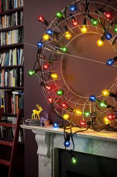 Here's a mantlepiece idea you don't see every day. This living space embraces the modern side of Christmas with colourful festoon lights wrapped around a wire wreath. Super cool and easy to achieve! Image: Livingetc