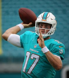 Ryan Tannehill of the Miami Dolphins warms up during a preseason game against the Atlanta Falcons at Sun Life Stadium on August 29 2015 in Miami...