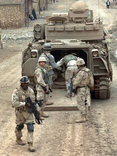 Soldiers from the Armored Cavalry Regiment load into an Bradley infantry fighting vehicle as they conduct a combat patrol in the streets of Tall Afar Iraq on Feb. Bradley Fighting Vehicle, Armored Fighting Vehicle, Army Vehicles, Armored Vehicles, Military Pictures, Military Equipment, Military Weapons, Modern Warfare, Us Navy
