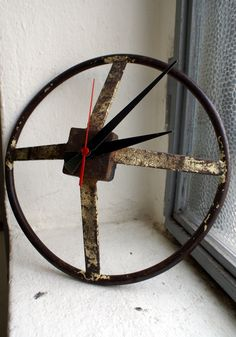 Wall clock made with a recovered industrial gear