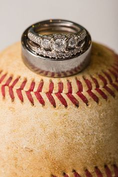 This couple hit a home run with their wedding ring set — we love how each major stone in the engagement ring setting features its own miniature halo.