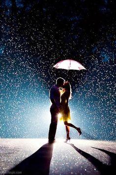 Passionate kiss in the rain.