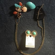 Jewelry bundle turquoise necklace & earrings Long necklace with turquoise stone as well as other glimmering stones and bling along with floral shaped turquoise earrings. Match Butch just enough different to make them a trendy statement combo Body Central Jewelry