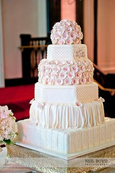 Pink & white wedding cakes.  Lots of details and each layer of the cake looked different.  Cake made by Sweet Memories in Raleigh, NC.