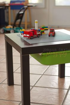 Another Lego table using an Ikea Lack table, but this one uses rails from the Trofast system and a Trofast bin for built-in storage. Perfect!