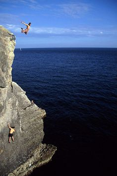 Leaping off cliff at the sea