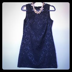 Black textured dress Forever 21 textured mini dress with fabric-covered buttons in back. Size M. Some minor wear, see pictures - otherwise excellent condition. Necklace not included. Forever 21 Dresses