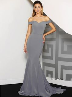 Chantel Dress. A stunning full length dress by Jadore. A fitted off shoulder style featuring a floor sweeping train.