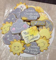 This order is for 1 dozen sugar cookies with a you are my sunshine theme including 2 each of -smiling cloud - cloud with writing when clouds are