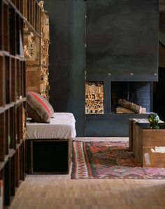Alessandro Capellaro loft - 300 old wooden voting boxes, vintage kilim and army blanket cushion