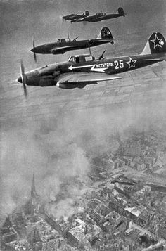 World War II, in Russia – the Great Patriotic War (22 June 1941 – 9 May 1945). Russian aircraft in the sky over Berlin. Photo by Mark Redkin. May 1945, Germany.