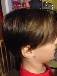 Boys hair cut with long bangs