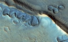 """Mark Watney is part of a six-member team that lands in a large northern basin on Mars, called Acidalia Planitia. This is where the crew establishes their home base, called """"the Hab."""" Here's the real life Acidalia Planitia, where shallow pits may have formed from ancient floods or glaciers."""