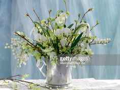 flowers arranged in silver | Snowdrops in White and Green Spring Bouquet in Silver Tankard : Stock ...
