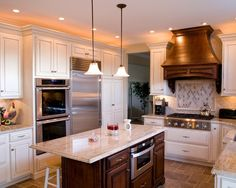 Enchanting Kashmir Gold Granite Ideas : Exciting Traditional Kitchen With Kashmir Gold Granite Countertops Also Classic Small Kitchen Island Design And White Classic Kitchen Cabinet Also Huge Stainless Refrigerator Also Classic Pendant Lights