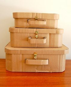 Cardboard suitcases: almost a tute, no pattern.    A good coat of papier mache would make these very sturdy.