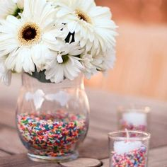 "Sprinkle-lined vases make a fabulous centerpiece for any birthday party. Nothing says ""celebration"" like sprinkles!"