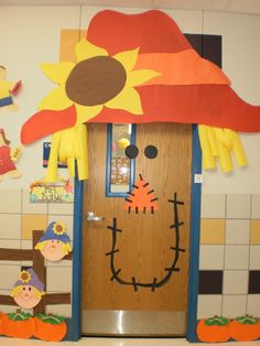 Scarecrow Door: This makes me miss the fun decorations teacerhs used to do when we were in elemtary school. We did a school walk through costume train where everyone put on costumes and class by class you walk through the whole school and each class joins the train after it passes into the classroom so everyone got to see all the costumes.  :)