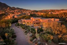 Single Family - Detached, Contemporary - Scottsdale, AZ Stunning Desert Oasis: With an elevated perch in Desert Mountain's Apache Peak, this soft contemporary begins with sweeping valley and mountain views.  Recent updates of wood plank and travertine flooring as well as stone accents and paint add to the warmth of the design.  Flowing floor plan includes Formal Great Room framing the views, & kitchen/ family room with fireplace which opens to the outdoor cooking & dining patio. Master suite…
