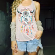 Bull Skull Dreamer Catch Tank 😍Yes Please!! This Super Cute Dreamy Bull Tank is lightly touched with Rhinestone Jewels!😻 Sooo soft and comfortable! 65% Rayon 35% Polyester. If you have any questions please feel free to ask! 😊 #PoshOnLadies! Bohemian Sea Tops Tank Tops