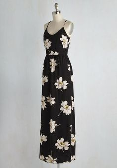 With a heart as warm as yours, it's a no-brainer that this black maxi dress makes for a brilliant personality match. White flowers with yellow centers drift down this racerback number, while a silver back zipper, a gathered waist, and a vented side bring added vim to your lovely appearance!