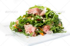 salad of arugula ham cheese on a white background ...  Prosciutto, antipasti, appetizer, arugula, balsamic, bio, calories, cheese, cherry, cuisine, diet, dressing, fig, food, fresh, fruit, gastronomy, gourmet, ham, healthy, italian, juicy, meal, meat, mozzarella, nutritious, oil, olive, rocket, salad, savory, spring, summer, sweet, tomato, vegetable, vitamin