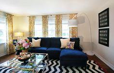 Yellow and blue living room features blue coral prints in bamboo ...