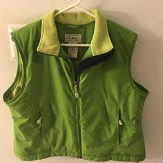 L.L. Bean women's vest. Size Large petite Like new condition. Vest is a very cool color of green!  Nylon shell with polyester lining.  Great for winter, spring and fall!!! L.L. Bean Jackets & Coats Vests