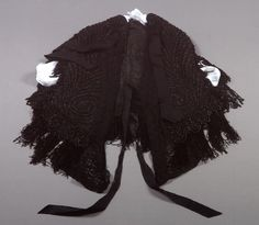 Beaded black crocheted mourning cape (mantelet), with grosgrain ribbon ties and beaded chenille fringe trim, American, ca. 1890.