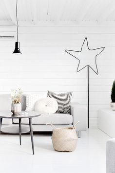 light grey couch, white wall with a little bit of black, i like!